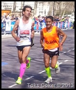 blind marathon runner strapped to his guid runner