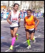 blind marathon runner strapped to his guid runner