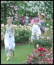 fairies dancing in the rose garden