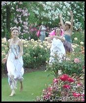 fairies dancing in the rose garden