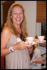 Gina serves tea