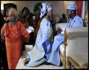 Bride kneels in front of Groom