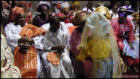 Groom's Family praying for Bride