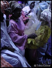 kneeling in front of grooms family