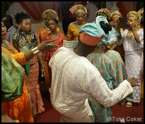 spraying money on married couple as they dance
